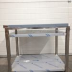 Table with reinforced shelf